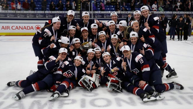 Team USA celebrates after winning gold in the IIHF World Championships.