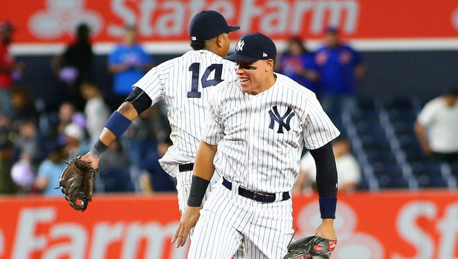 Aaron Judge and Starlin Castro celebrate after the Yankees' beat the Cardinals, 9-3, on Sunday. The Yankees have won seven straight games.