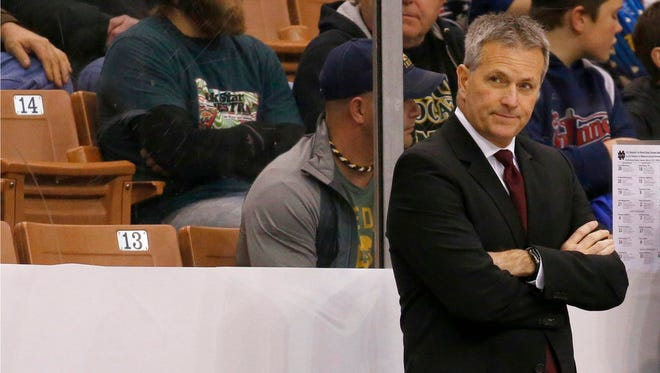 In this March 25, 2017, file photo, Minnesota head coach Don Lucia looks on from the bench before the start of an NCAA regional men's college hockey tournament game against Notre Dame, in Manchester, N.H. Longtime Minnesota hockey coach Don Lucia is stepping down after a disappointing year that ended with the Gophers missing the NCAA Tournament.