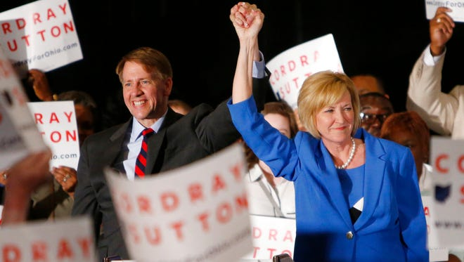 Democratic gubernatorial candidate Richard Cordray, left, and his running mate Betty Sutton greet a crowd of supporters during an election night event.