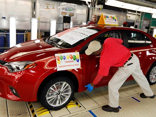 A quality inspector checks the finish of the 500,000th Corolla to be assembled at the Toyota plant in Blue Springs, Miss., on Feb. 12, 2015. The plant is the only one in the United States that builds the entire Corolla line.