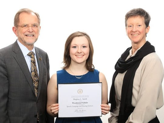 Meghan Smith is a Pennfield High School graduate. Pictured with her: WMU President John Dunn and WMU Faculty Senate President Suzan Ayers.