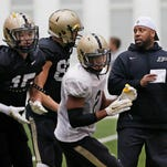 Defensive backs coach Taver Johnson, right, wth instructions for players at the start of a drill during Purdue spring football practice Thursday, March 26, 2015, in the Mollenkopf Athletic Center.