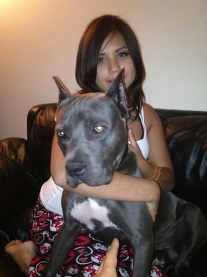 Beverly Guerra, shown with her dog, enjoyed shopping and hanging out, according to a friend. Police say she was killed by Michael Richard Martinez, her boyfriend, early Thursday morning.