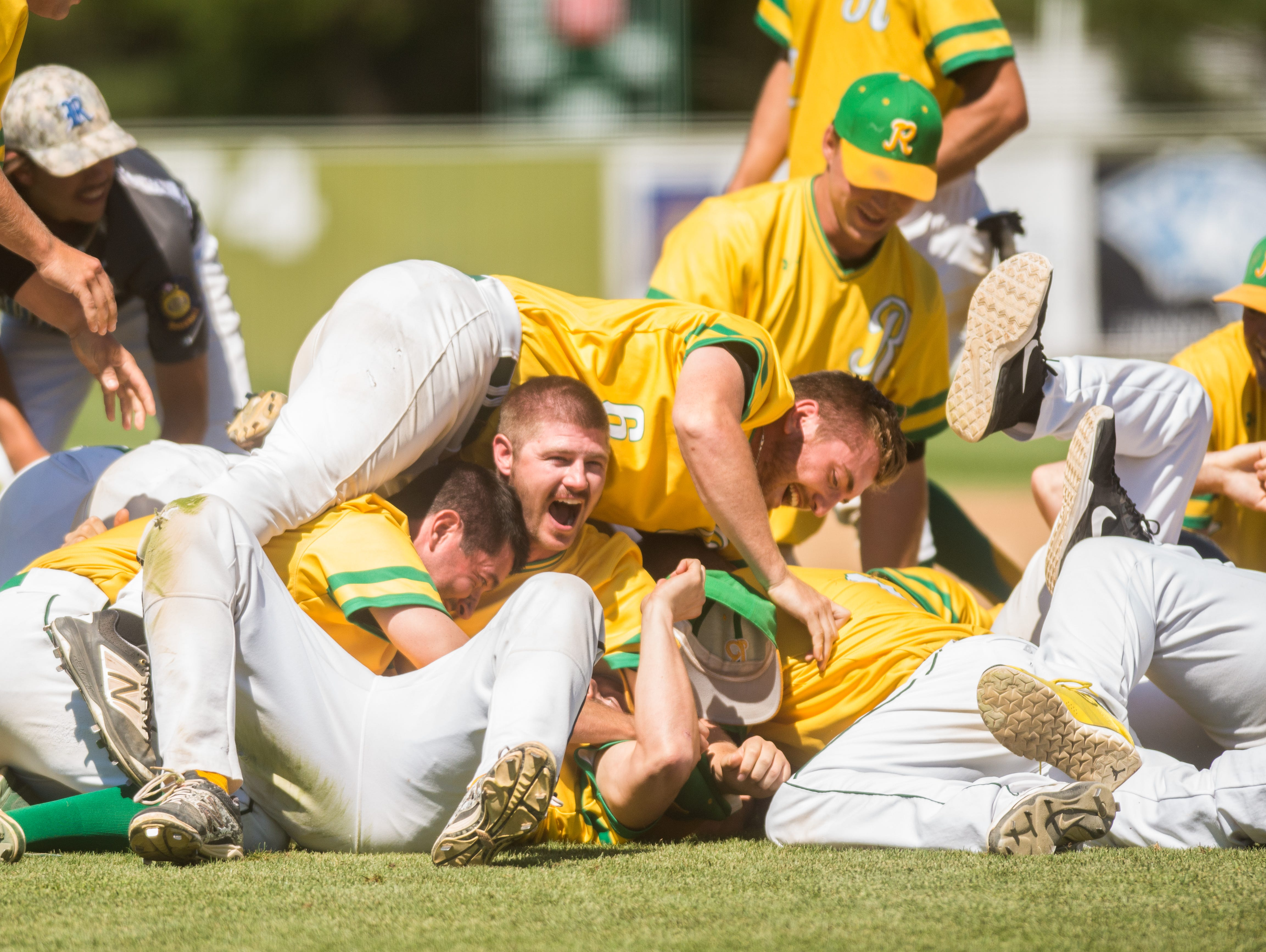 Members of the Renner Monarchs celebrate their win over the Sioux Falls Brewers at the South Dakota Class A Amateur Baseball Championship at Caldwell Park, Mitchell, S.D. The Renner Monarchs wins 6 - 5 over the Sioux Falls Brewers.