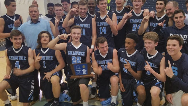 Shawnee's boys' basketball team poses with its South Jersey Group 4 championship trophy after at 76-72 win over Toms River North on Tuesday.