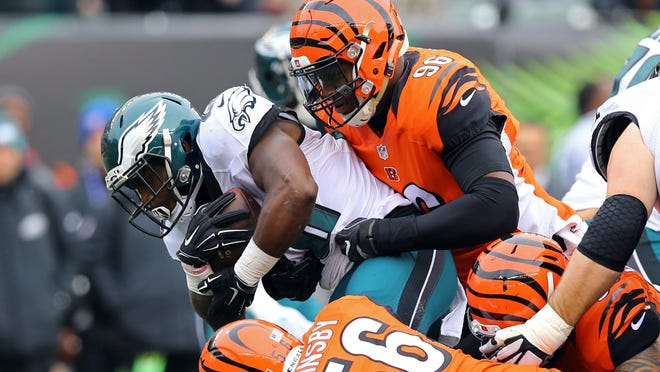 Dec 4, 2016; Cincinnati, OH, USA; Philadelphia Eagles running back Wendell Smallwood (28) is tackled by Cincinnati Bengals defensive end Carlos Dunlap (96) in the first half at Paul Brown Stadium. Mandatory Credit: Aaron Doster-USA TODAY Sports