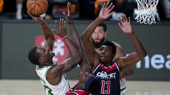 Boston's Javonte Green heads for the basket against the Washington Wizards last Thursday in Lake Buena Vista, Fla. The Celtics begin a seven-game series against Philadelpia on Monday.