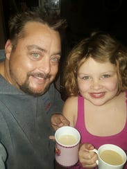 Michael Reed with daughter Lily, 9. Lily is missing