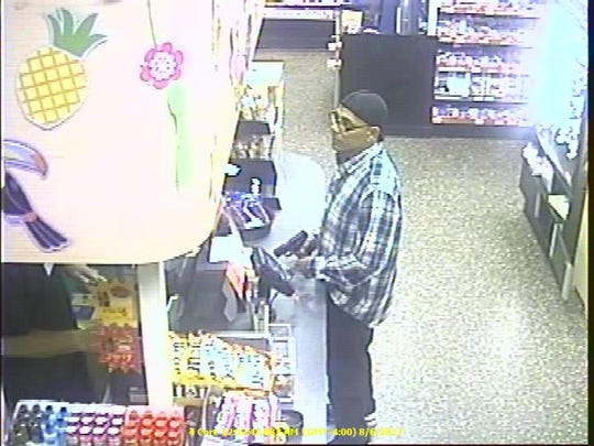 Surveillance footage captured a man robbing a Wawa in Springfield Township in August 2017.