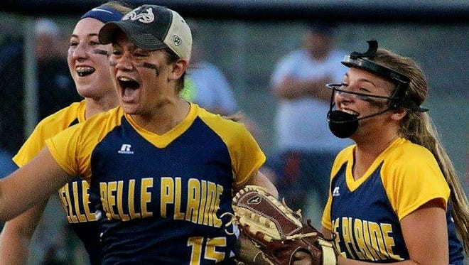 Rightfielder Tori Hlas celebrates making the final out in Belle Plaine's defeat of AGWSR Monday, July 10, at Ackley. She is shown with teammates Grace and Lilly Parrot. Belle Plaine advanced to state on Monday against Clarksville.