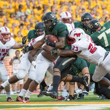 Baylor Bears running back Shock Linwood (32) runs for a touchdown against the Southern Methodist Mustangs during the game at McLane Stadium in Waco on August 31, 2014.