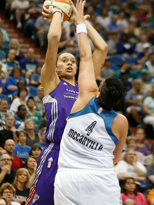 Phoenix Mercury center Brittney Griner (42) shoots the ball against Minnesota Lynx center Janel McCarville (4) in the first half of a WNBA basketball game, Thursday, July 31, 2014, in Minneapolis. (AP Photo/Stacy Bengs)