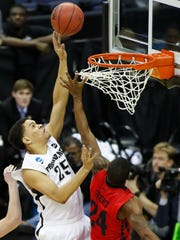 Providence Friars forward Tyler Harris (25) shoots