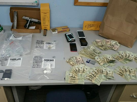 A search warrant served Thursday morning caused detectives to seize marijuana, cocaine, heroin and more than $1,600 in cash.