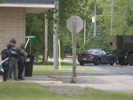 Law enforcement gather on Division Street on Wednesday during a stand off in Bancroft.