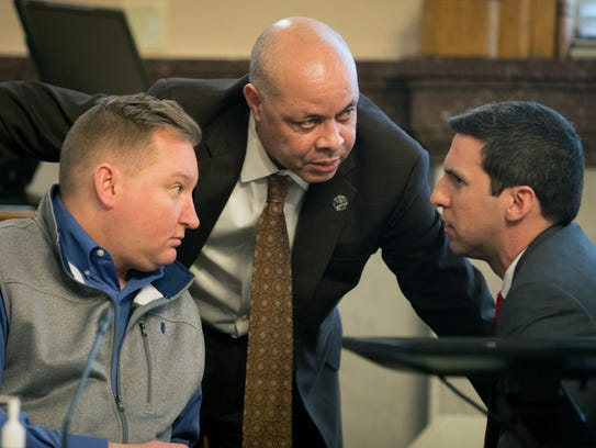Cincinnati City Manager Harry Black, center, talks