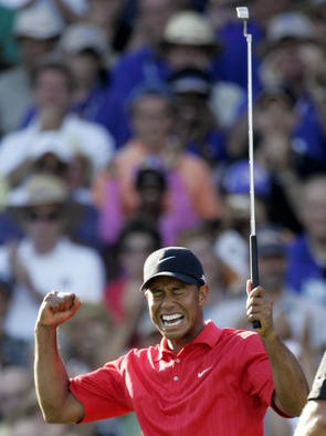 Tiger Woods celebrates after winning the 88th PGA Championship golf tournament at Medinah Country Club, Sunday, Aug. 20, 2006, in Medinah, Ill. (AP Photo/Rob Carr)