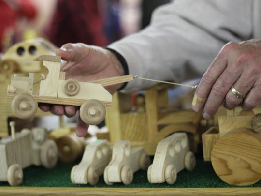 Ron Nissen, of Green Springs, builds all of his wooden toys by hand, like this working tow truck.