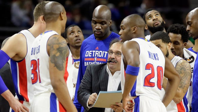 Detroit Pistons head coach Stan Van Gundy, center, talks to his team during a time-out against the Atlanta Hawks on Jan. 9, 2015, in Auburn Hills.