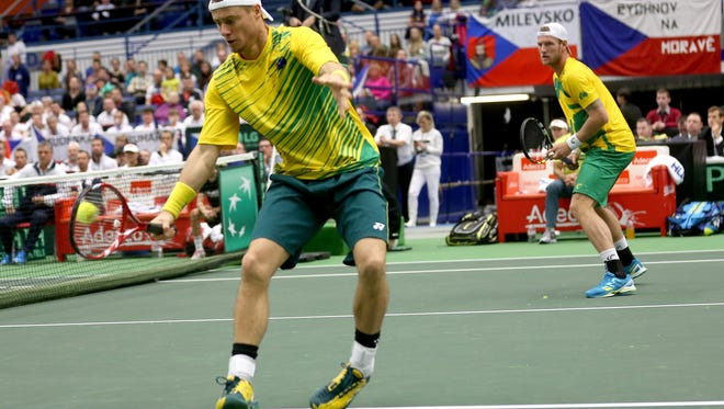 Lleyton Hewitt, left, returns as his partner Sam Groth looks on during their Davis Cup World Group first round doubles tennis match in the Czech Republic, Saturday, March 7, 2015. (AP Photo/CTK, Petr Sznapka)