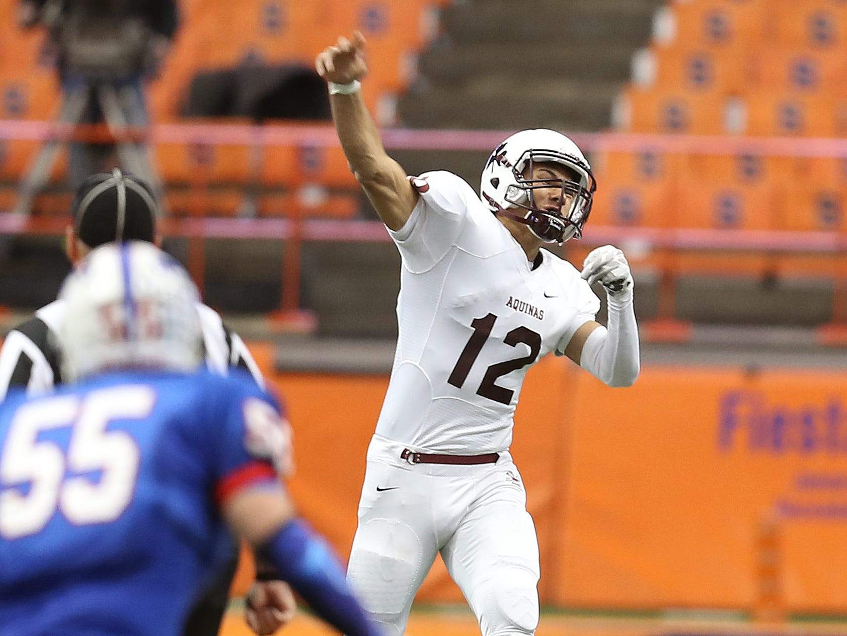 Aquinas quarterback Jake Zembiec goes deep for a touchdown pass to Earnest Edwards. Zembiec threw for 462 yards and 4 touchdowns as they beat Saratoga Springs to win the State Class AA title.