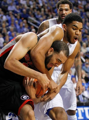 Kentucky's Karl-Anthony Towns wrangled with Georgia's Kenny Gaines Tuesday night at Rupp Arena in Lexington. Towns owns scored 15 points as well as a team high 13 rebounds in the Wildcats' 69-58 win over the Bulldogs. By Matt Stone, The Courier-Journal February 3, 2015