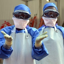 Liberian health workers are seen at the NGO Medecins Sans Frontieres (Doctors Without Borders) Ebola treatment center in Monrovia, on October 18.