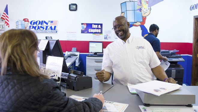 David Jackson talks with customer Sylena Moon at his Goin' Postal franchise in Piedmont, S.C. Small businesses have been the backbone of economic growth since the end of slavery, starting in places like Black Wall Street in Oklahoma and Harlem.