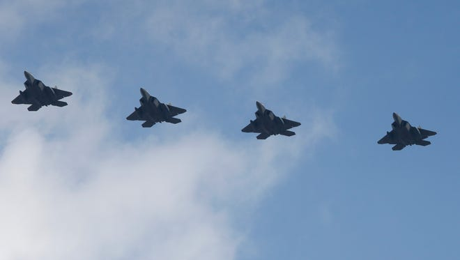 Four U.S. F-22 stealth fighters fly over Osan Air Base in Pyeongtaek, South Korea, Feb. 17, 2016.