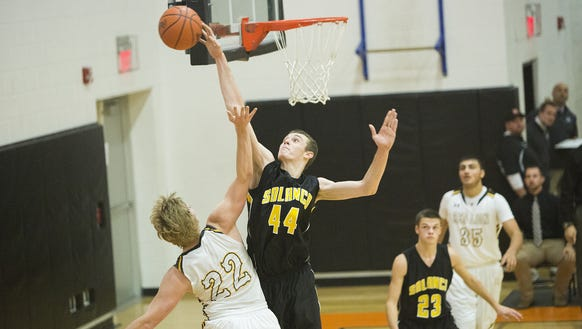 Red Lion's Wyatt Tyson has his shot blocked by Solanco's