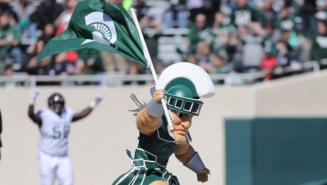 Sparty plants the flag on the field before the Michigan State Spartans spring game at Spartan Stadium, Saturday, April 1, 2017.