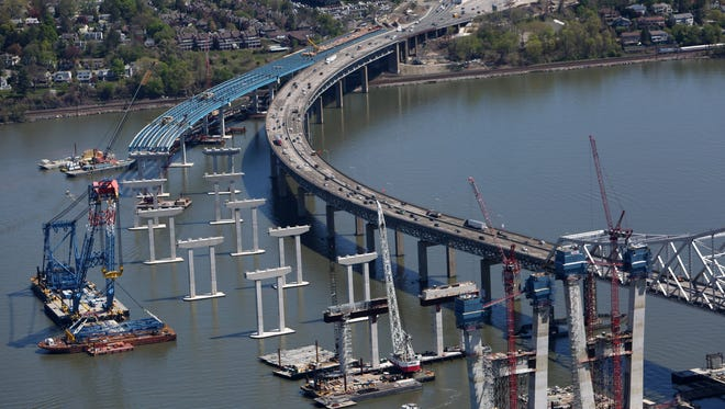 The Left Coast Lifter and other construction equipment works on the Tarrytown side of the new Tappan Zee Bridge April 27, 2016.