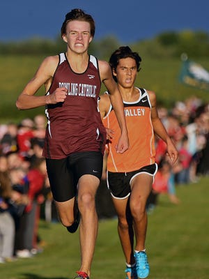 Ryan Schweizer of Dowling Catholic, left, turned on the speed to break away and take first place as Valley's Daniel Soto would finish second at the Marshalltown Invitational.