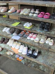 In a Tuesday, Feb. 10, 2015 photo, baby shoes from