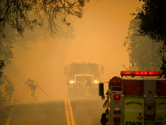 Firefighters work to contain a wildfire in Spring Valley, Calif., Sunday, June 24, 2018. Wind-driven wildfires destroyed buildings and threatened hundreds of others Sunday as they raced across dry brush in rural Northern California.