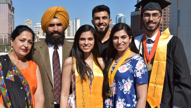 Academic excellence runs in the Grewal family. From left are parents Pam and Darshan, both Milwaukee Public Schools teachers, and their four children who were all valedictorians at Riverside University High School in Milwaukee: Raj in 2014, Gurtej in 2017, Rupi in 2011 and Sirtaj this year.