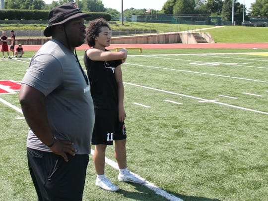 From left, Central High School football coach Lorenzo