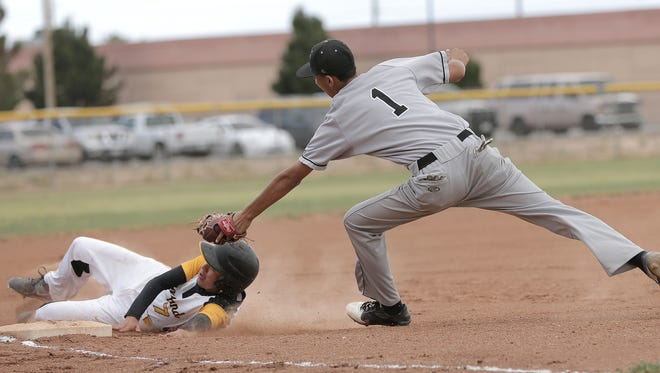Parkland's Carlos Manriquez slides in to third base past Hanks third baseman Ruben Alcala Tuesday afternoon at Parkland High School. Manriquez was called out.