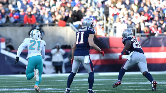 Dolphins safety Eric Rowe returns a Tom Brady pass 35 yards for a touchdown in the 2019 finale at New England.