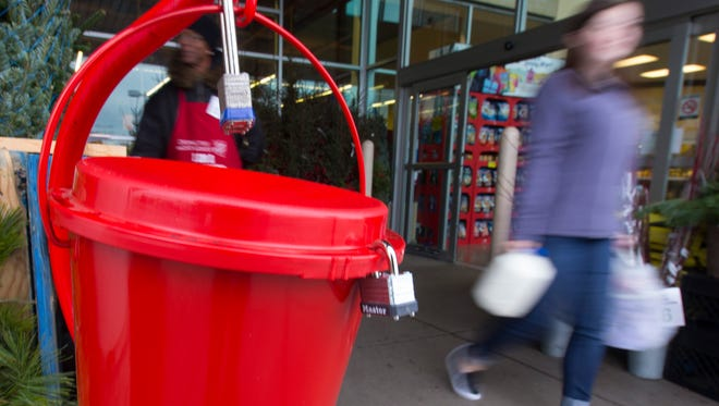Patrons pass a Salvation Army kettle in November outside Pick 'n Save on N. Port Washington Road in Glendale.