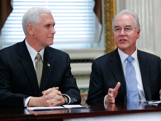 Vice President Mike Pence listens at left as Price