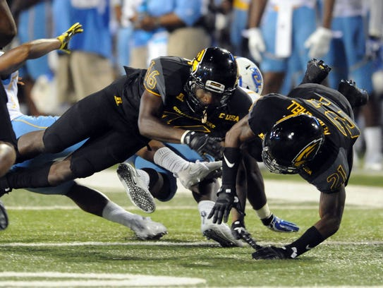 Southern Miss freshmen defensive backs Tyler Barnes (46) and Rachuan Mitchell (21) make a play during a win over Southern University.