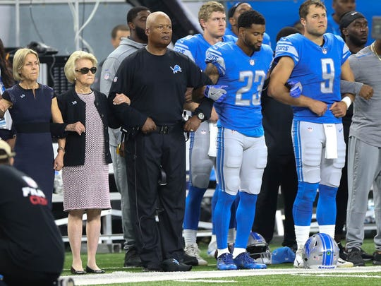 The Detroit Lions took a knee and joined arms in protest of statements made by President Trump before action against the Atlanta Falcons on Sept. 24, 2017, at Ford Field in Detroit.