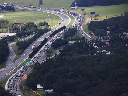 Traffic backs up Sept. 7, 2017, on northbound Interstate 75 at its intersection with the Florida Turnpike as residents flee Hurricane Irma.