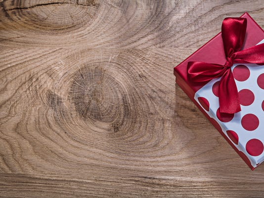 Red boxed birthday present on wooden board copy space holidays