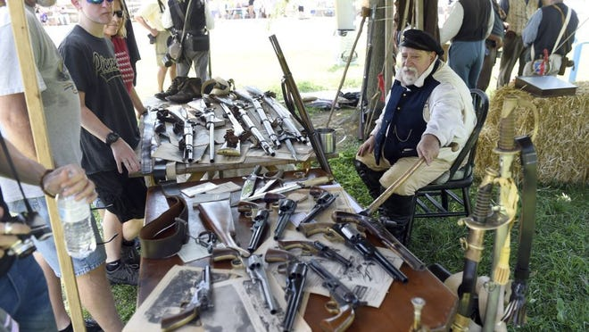 Wayne Aldridge of Daylight gives information about old military weapons last year after a Civil War-era re-enactment of what happened on July 18, 1862, in Newburgh.