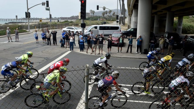ANTHONY PLASCENCIA/THE STAR Fans line the street as cyclists round a turn at Sanjon Road in Ventura as Stage 3 of the Amgen Tour of California winds its way through Ventura County earlier this year.