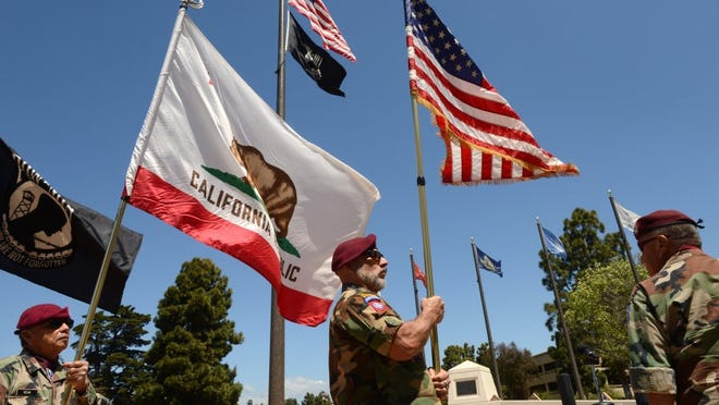 Edward Vega (from left), Miguel Angel Martinez and Rudy Garcia are part of the color guard for a flag replacement ceremony held in April at the Ventura County Veterans Memorial in Ventura.