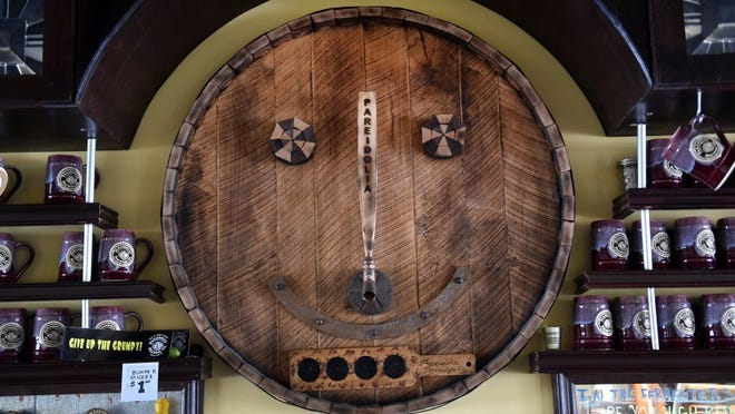 "Pareidolia Man, the logo for Pete Anderson's pub Pareidolia Brewing Co. in Sebastian, is seen above the bar. ""Pareidolia"" is a psychology term meaning the perception of a recognizable image of a meaningful pattern where none exists or is intended. (ERIC HASERT/TREASURE COAST NEWSPAPERS)"